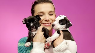 Millie Bobby Brown Plays With Puppies While Answering Fan Questions