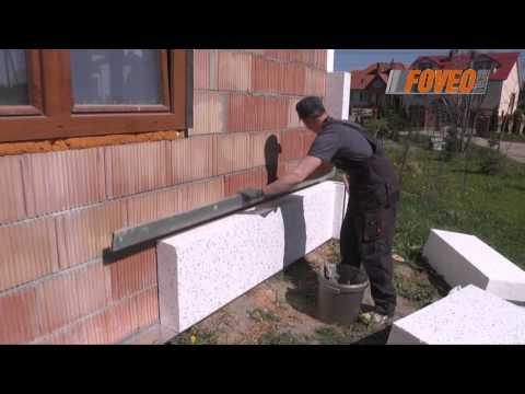 2. Ocieplanie budynku. Przyklejanie styropianu.