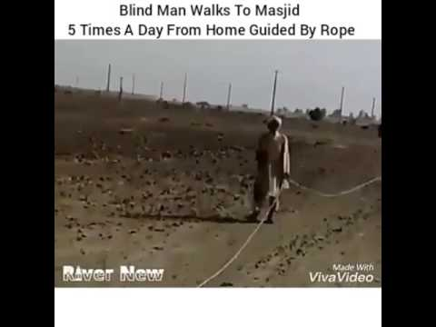 Saudi Arabia, man walks guided by rope from his home 5 times a day for salah.