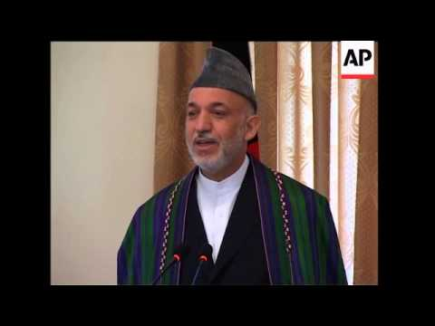 Afghan president defends vote, admits some bias