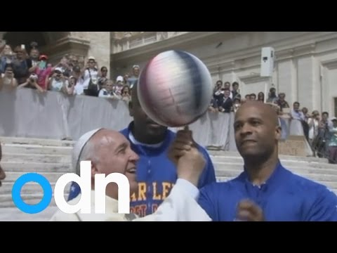 Pope tries his hand at basketball as the Harlem Globetrotters visit the Vatican