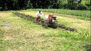 Kubota 2 Wheel Tractor Plowing Farm Field