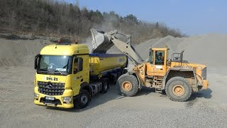 Mercedes-Benz Arocs 1848 load by Volvo L150D