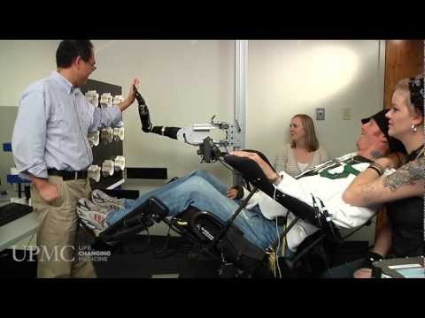 Paralyzed man moves robotic arm with his thoughts