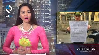 Nhân viên cục điều tra hình sự Bộ Quốc Phòng kêu oan trước trụ sở tiếp công dân Trung ương Hà Nội