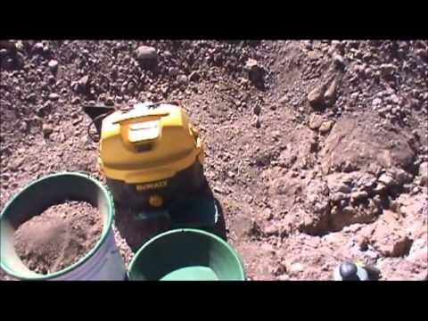 Prospecting For Gold In In A Desert Wash Crevicing and Crack Vac'ing