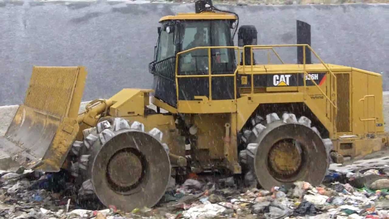 Crushing garbage with a cat 826h compactor loader youtube Garbage compactor