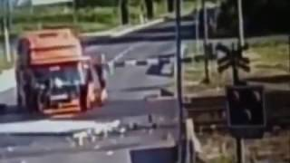 Train pulverizes truck at a railroad crossing
