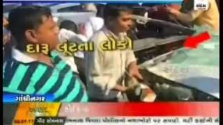 Car Accident, People robbed liquor nr Sargasan Cross Road, Gandhinagar