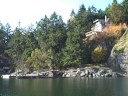 Boating into Comfort Cove Cottage near Sooke, BC