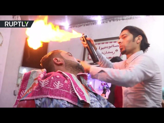 'Good for blood circulation' Palestinian barber creates hairdo using fire