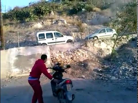Manguy cayendose de la moto