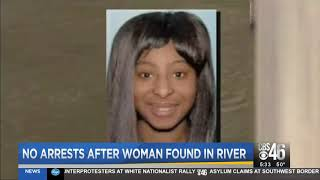 No arrest after woman found in river