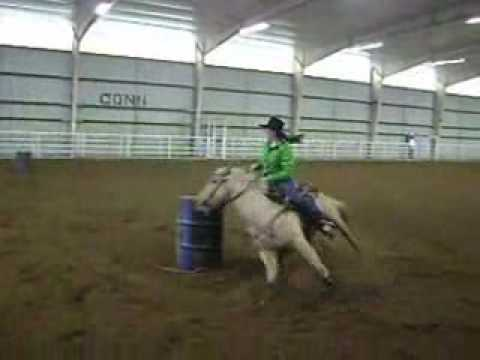 Stephanie Wolfe and Chickin running barrels at Connors State College