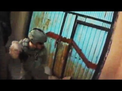 Soldiers Kick Down Taliban Compound Door After Ambush