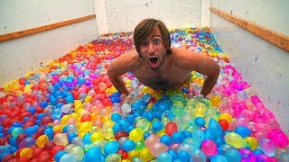 Moving truck FILLED with 10,000 WATER BALLOONS!