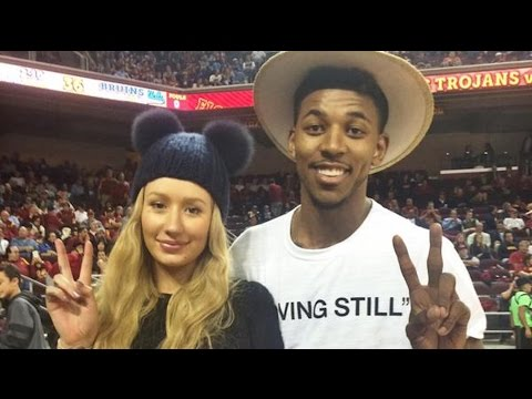 Iggy Azalea Licks Nick Young's Face on Kiss Cam at USC vs. UCLA Game