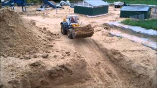 Part 1 - Building of a rain retention reservoir with RC construction machines!