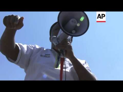 Malema addresses striking miners; miners stage protest over pay