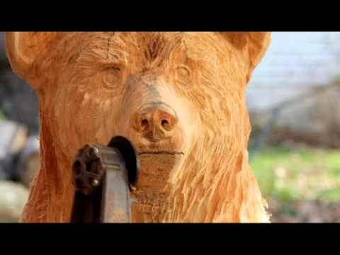 How to Chainsaw Carve a bear cub in a stump - YouTube