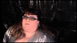 15 004-  BBW FetishKimmy in Black PVC Corset, Silver Heels, PVC Top and Silver Spandex Leggings