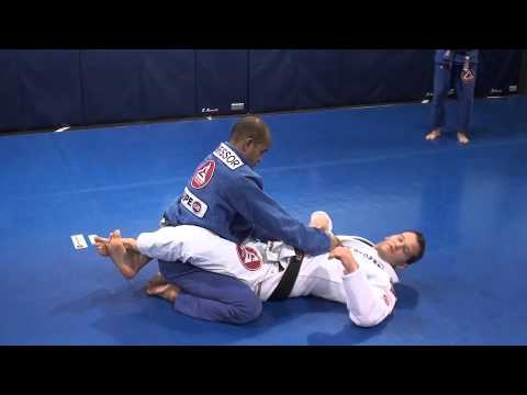 Triangle choke set up from closed guard using belt control Image 1
