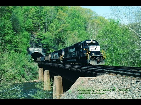 Coal train with helpers BLAST out of one tunnel, and into another. 5/01/2000