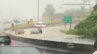 Drivers rescued by fire crew after torrential rain floods Highway 401 ramp