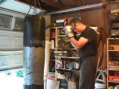 Heavy Bag Training by Keith Herrel - Set 7 - Knee Hook Kick, Overhand Punch Image 1