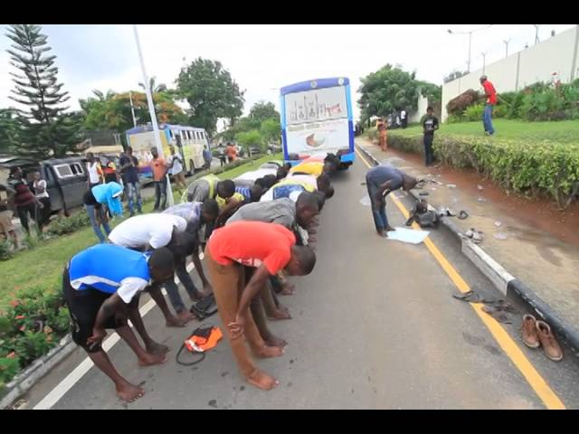 LASU students praying in front of Lagos state office - Sodiq Adelakun