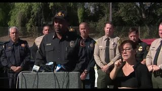 Officials hold a news conference on the Woolsey Fire