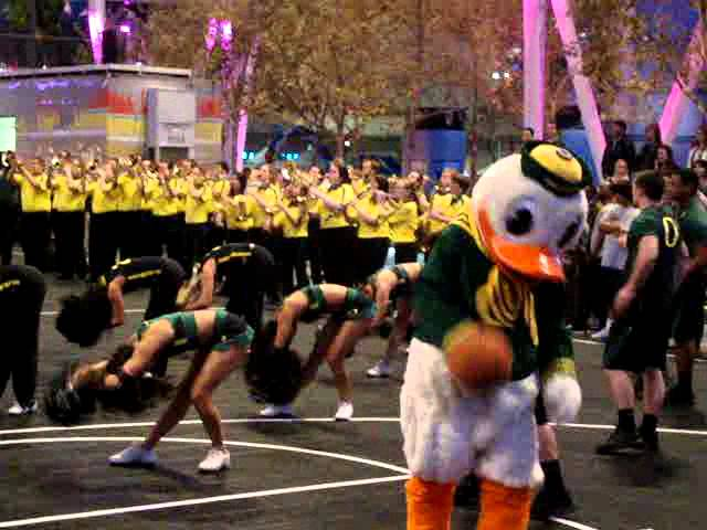 The Duck and Chip screw around while Oregon cheerleaders perform at Pac-12 tournament 3-08-12