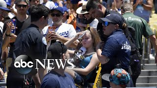 Woman hospitalized after being hit by foul ball