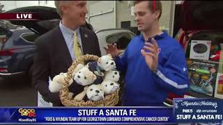 FOX 5, Hyundai deliver Stuff A Santa Fe toys