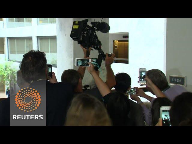 Protester asks Jared Kushner to sign Russian flag