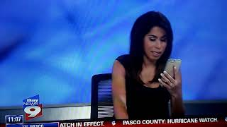 Bay News 9 anchor talking on cell phone on live TV