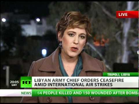 RT's Paula Slier reports live as anti-aircraft fire rains out over Tripoli