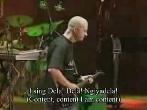 Johnny Clegg and Savuka - Dela - Lyrics - YouTube