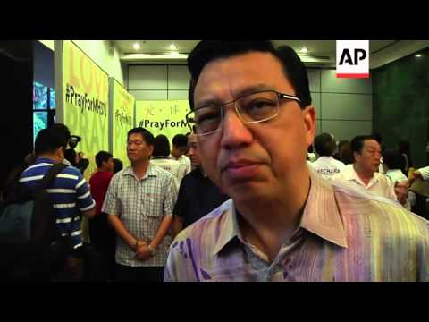 """Malaysia prayer service, JACC chief on """"pulses"""" detected in search for jet"""