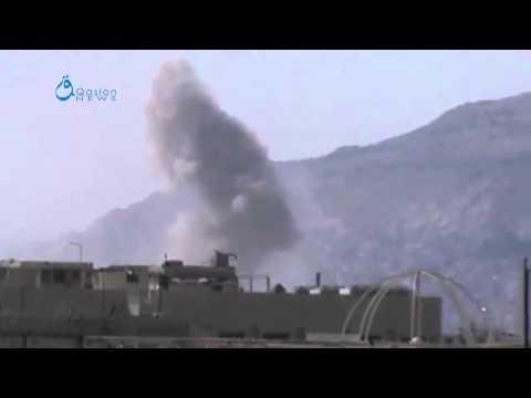 Q.News:Damascus:Heavy smoke raising due to the airstrikes over Jobar neighborhood18-3-2015