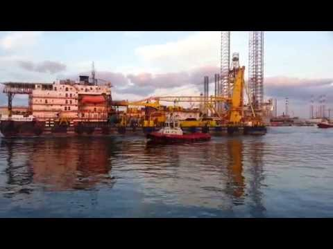 Pipelay Barge & Tug Boat inside channel