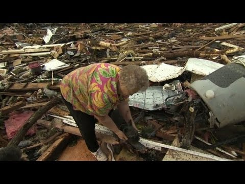 Woman reunited with dog amid tornado wreckage