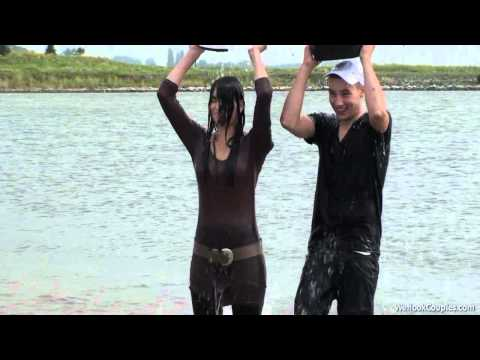 Young couple playful in wet clothes