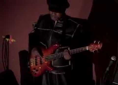 Africa's best-known bass player, Ngouma Lokito, warming up