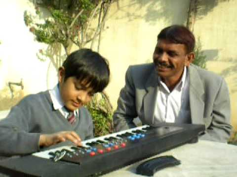 city school student shah masoom with his sir pashto song.AVI