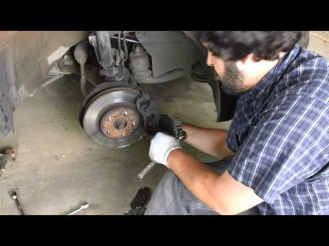 2004 Toyota Sienna LE Right Front Brake pad replacement.MP4