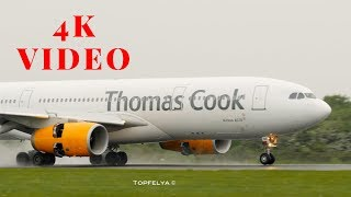 Thomas Cook landing at Rainy Manchester airport Airbus A350 Singapore airline spectacular take-off