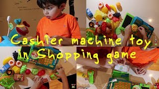 Philo with Kitchup opening the new cashier machine toy and play with it