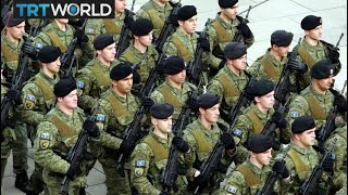 Why is Serbia objecting to Kosovo having its own army?