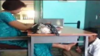 Caught on camera: school teacher makes student massage her feet
